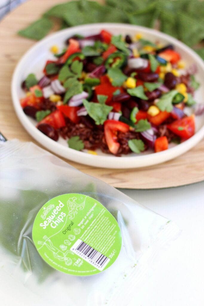 plant-based mexican salad with a bag of seaweed tortilla chips